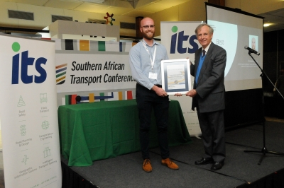OUTSTANDING: Thomas Farrar, a Senior Lecturer in the Maths and Physics Department, receives the award for Best Paper at this year's annual Southern African Transport Conference.