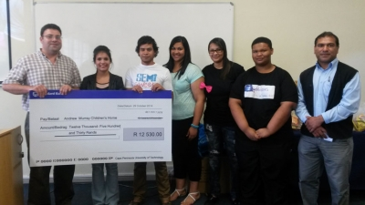 WORTHY CAUSE: The Office and Management students and Lecturer Mohamed Badat (right) hand a cheque to Huis Andrew Murray manager Regardo Scholtz (left) at the Wellington Campus