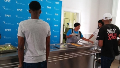 HELPING HANDS: Aunty Des from Boland Catering was on hand to give a much needed meal to hungry students on CPUT's Wellington Campus