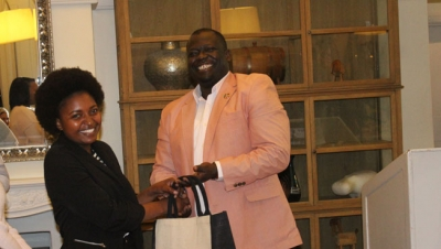 EMPOWERMENT: Centre for Enterprise Research Partnership and Innovation in Africa manager Jerry Ansen congratulates a graduate who recently completed the SAP training during the launch of an initiative to skill 100 CPUT women in SAP digital business skills.