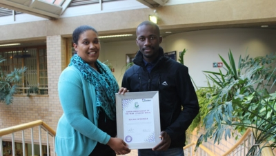 GREEN LIVING: Student Development Officer Melani-Ann Hara congratulates Xolani Ntshinga for scooping the Green Ambassador of the Year award during the national Green Campuses Conference held at UWC recently.