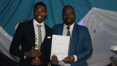 Vice-chancellor, Dr Chris Nhlapo, congratulates one of the winning academic giants during the recent Residence Life Academic and Sport Awards Night on the Wellington Campus.