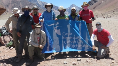 DONE DEAL: Research participants led by Professor Simeon Davies, HoD: Sport Management (standing on the right in the back row), fly the CPUT flag on Aconcagua mountain