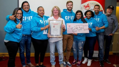 VICTORIOUS: Kate Jones (middle) and Denis Da Silva (far right) from AB InBev congratulate the CPUT brewing champions for their winning entries into the annual SAB Intervarsity Beer Brewing Challenge