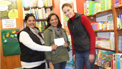 BOOKED: Melody Volmink, Literacy tutor and Relationship Co-ordinator at Help2Read and Bargain Books manager Anneli Odendaal congratulate CPUT student Corne Conradie (centre) for winning the naming competition